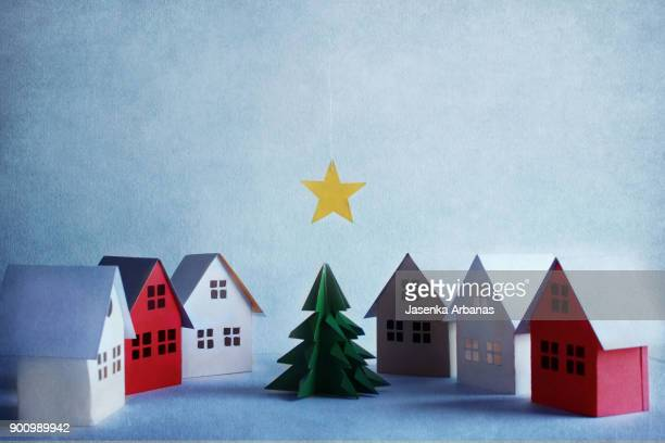miniature houses and christmas tree - holiday card stock photos and pictures