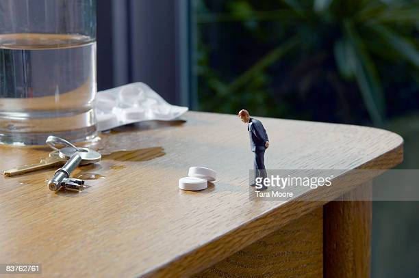 miniature man looking at tablets - figurine stock pictures, royalty-free photos & images