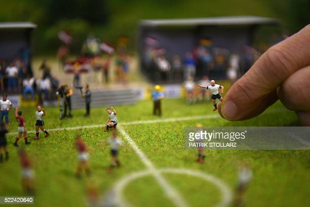 A miniature model of a football game scenery in a scale of 187 is pictured during a photo preview for the 'Intermodellbau' trade fair on April 19...