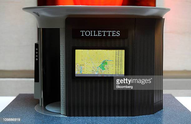A miniature model of a public toilet operated by the JCDecaux company stands on display at a news conference in Paris France on Wednesday March 9...