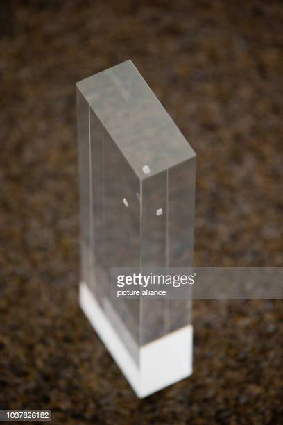 A miniature model of the planned artwork 'Rolihlahla' a transparent block made from acrylic glass containing a raw diamond is pictured in Nuremberg...