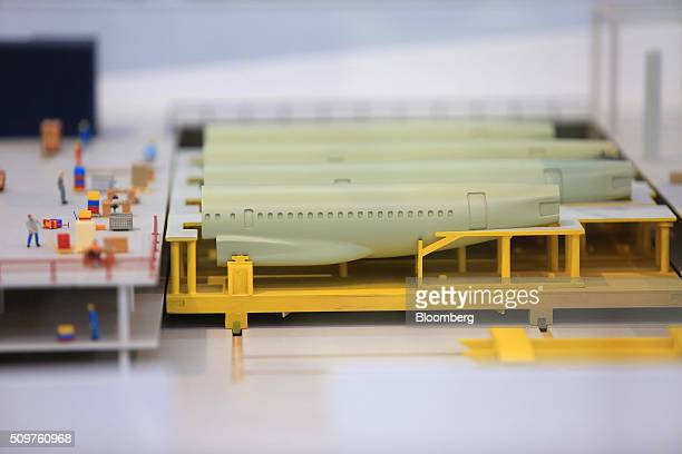 Miniature models of Airbus A320 aircraft fuselage sit on the assembly line inside the Airbus Group SE factory in Hamburg Germany on Friday Feb 12...
