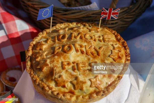 Miniature novelty flags from the European Union left and a Union Flag also known as a Union Jack stand in a pie on the stand of an antiBrexit...