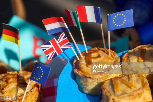 Miniature novelty flags of various European countries stand in pies on the stand of an antiBrexit campaign near the Houses of Parliament in London UK...