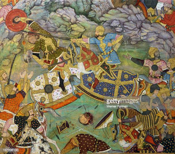 Miniature painting depicting Tambal attacking his cousin Babur while their armies battle in a rocky landscape From the Baburnama an autobiographical...