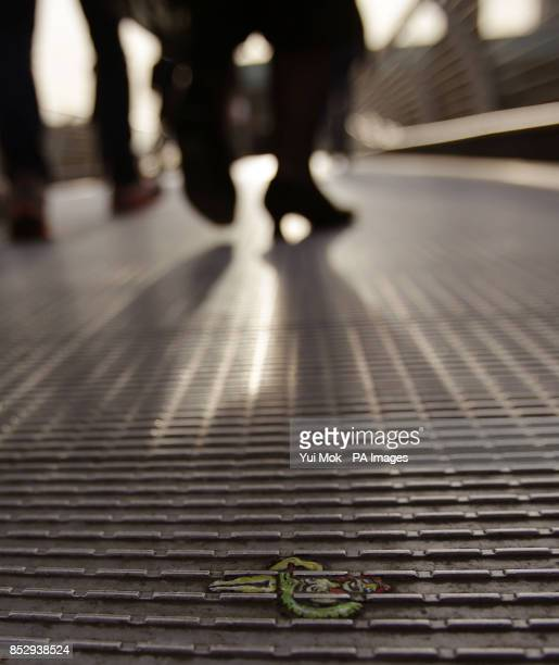 A miniature piece of art on the Millennium Bridge by artist Ben Wilson who paints art on discarded gum and is also known as 'Chewing Gum Man' central...