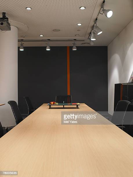 Miniature ping pong set on a boardroom table