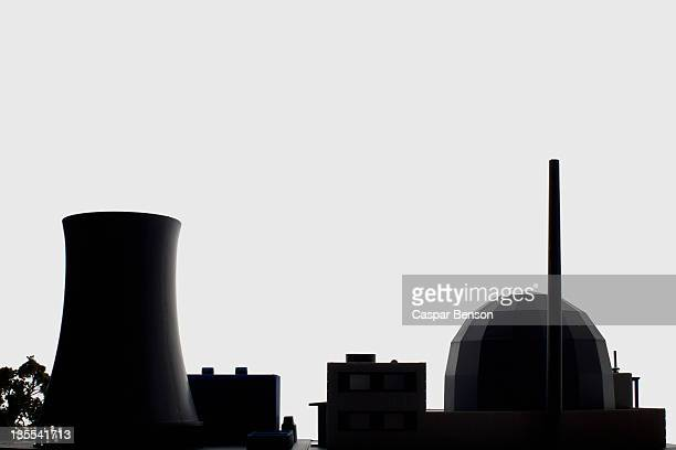 A miniature power station in silhouette