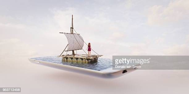 Miniature raft at sea with woman on a mobile phone