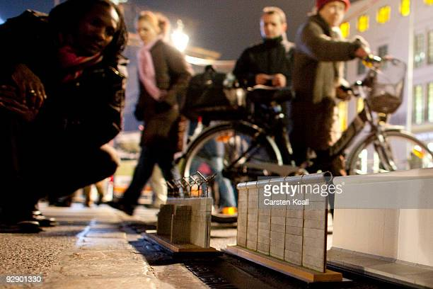 Miniature replicas of the Berlin wall are displayed at the Brandenburg Gate to commemorate the 20th anniversary of fall of the Berlin Wall on...