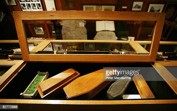 Miniature sample coffins from the 1920s are displayed at the