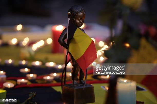 Miniature sculpture of Brussels' landmark Manneken Pis is seen in tribute to victims at a makeshift memorial in front of the stock exchange at the...