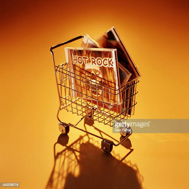 miniature shopping cart with music cds - modern rock stock pictures, royalty-free photos & images