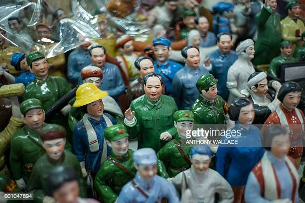 A miniature statue of Mao Zedong is displayed with statues of Red Guards at a stall in Hong Kong on September 9 which marks 40 years since Mao's...
