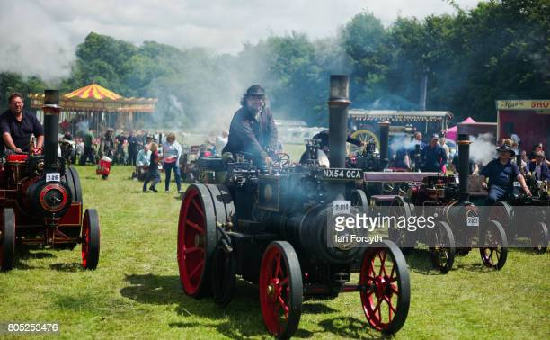 Miniature steam engines are driven into the main arena during the Duncombe Park Steam Rally on July 1 2017 in Helmsley United Kingdom Held annually...