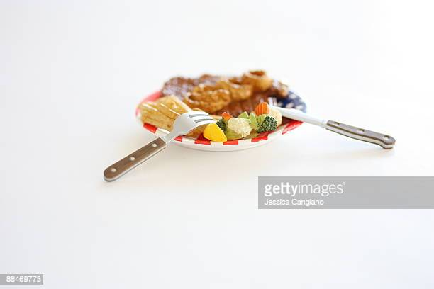 Miniature toy of steak supper with knife and fork