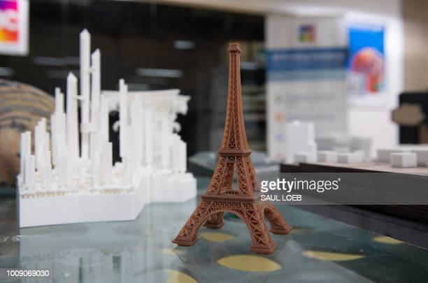A miniature version of the Eiffel Tower made from a 3Dprinter is seen at ABC Imaging in Washington DC on August 1 2018 A US judge on July 31 2018...