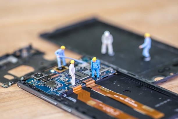 Miniature worker, technician repairing Mobile Repairer