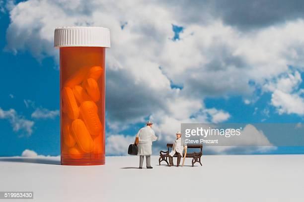 Miniatures beside a pill bottle