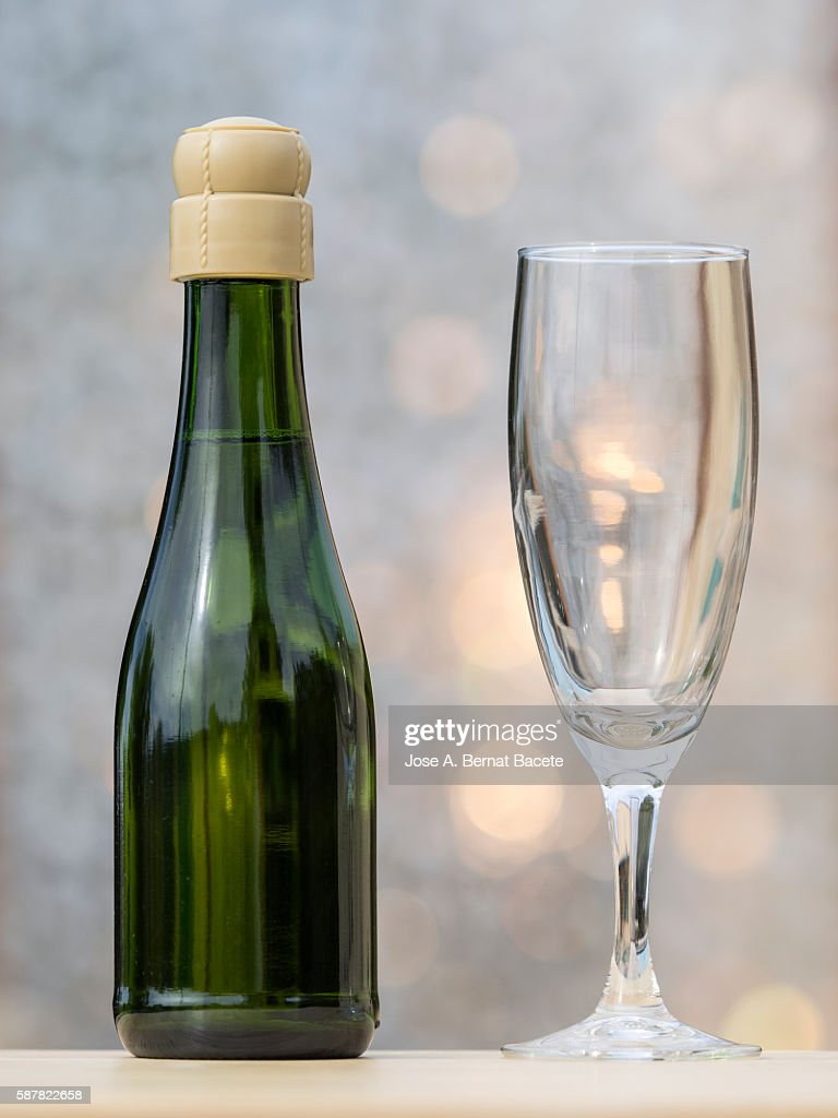 Minibar bottle and glass of champagne : Stock Photo