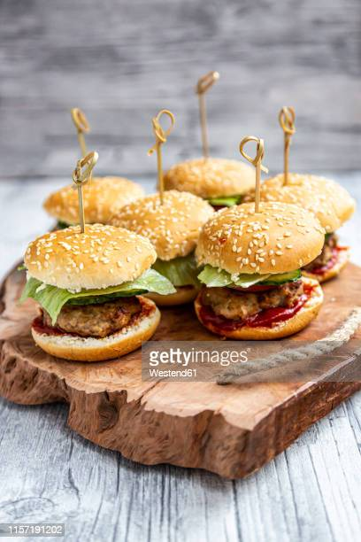 mini-burger with mincemeat, salad, cucumber and tomato on wooden tray - unhealthy living stock pictures, royalty-free photos & images