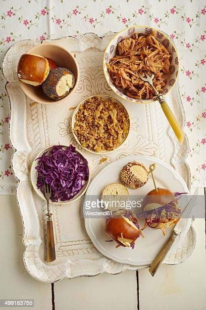Mini-Burger with pulled pork, red cabbage and fried onions on tray