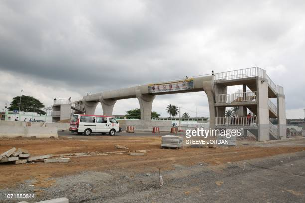 A minibus drives under a newly built overpass at a new section of the N1 at the PK11 district of Libreville in Gabon on December 5 2018 With its...