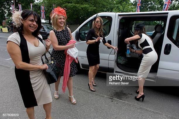 A minibus of women arrive at the racecourse during the annual Royal Ascot horseracing festival in Berkshire England Royal Ascot is one of Europe's...