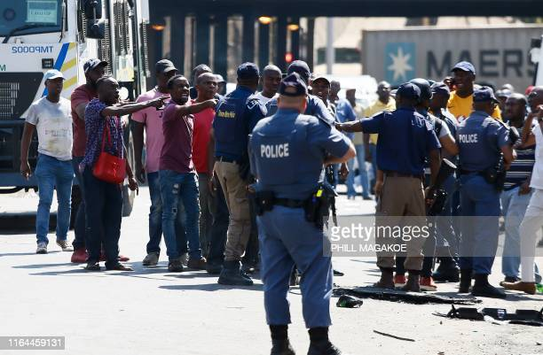 Minibus taxi drivers argue with South African Police Service members during a taxi drivers' riot near the Bloed Taxi Rank on August 28 in Pretoria...