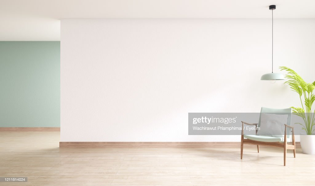 Minimal Interior Of Living Room, Wood Armchairs With Plant On Wood Flooring : Stock Photo