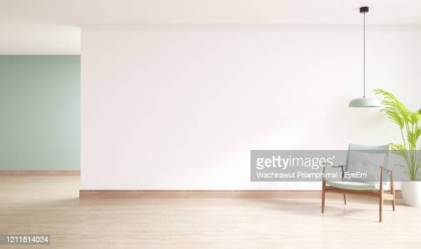 minimal interior of living room, wood armchairs with plant on wood flooring - indoors stock pictures, royalty-free photos & images