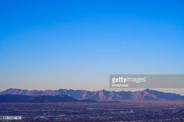 minimal simple landscape of mountains and big blue sky - clear sky stock pictures, royalty-free photos & images