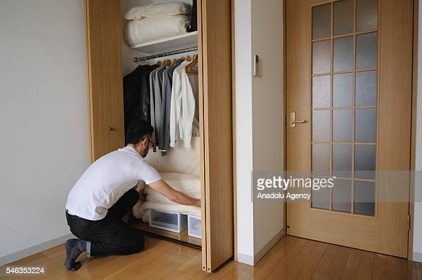 Minimalist Fumio Sasaki stores away his futon mattress in his apartment in Tokyo Japan on June 24 2016 Fumio Sasaki Editor decided to live less...