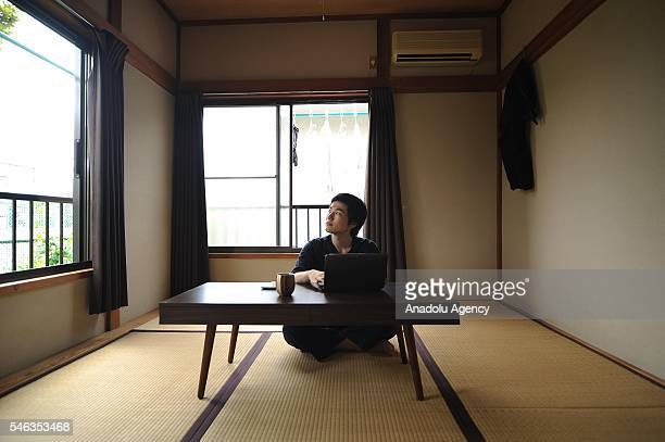Minimalist Katsuya Toyoda sits in a tatami room at his appartment in Tokyo Japan on July 02 2016 Katsuya Toyoda an online publication editor decided...