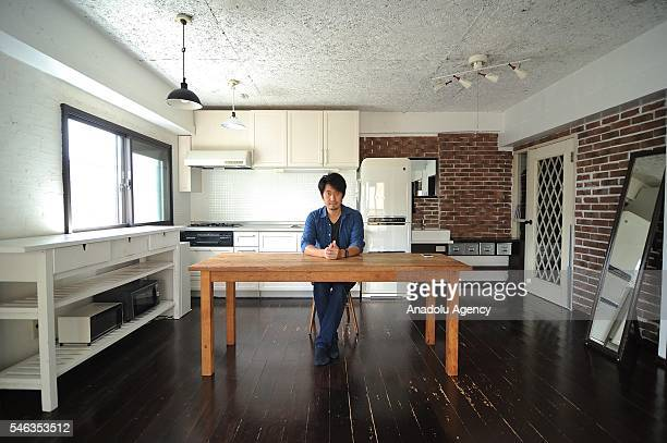 Minimalist Naoki Numahata sits in the kitchen at his apartment in Tokyo Japan on July 12 2016 Naoki Numahata a freelance writer who lives with his...