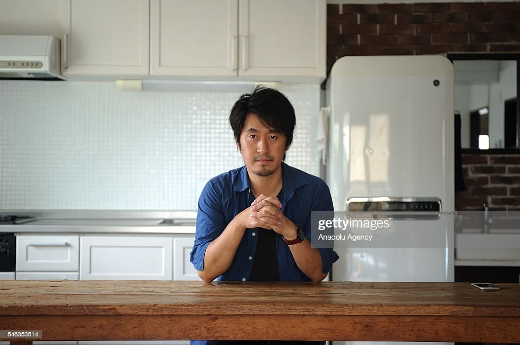 Minimalist Naoki Numahata sits in the kitchen at his apartment in Tokyo, Japan, on July 12, 2016. Naoki Numahata, 41, a freelance writer who lives with his wife and their daughter, decided to live less cluttered with useless personal and domestic possessions during a travel and after meeting a family who live quite simply in Croatia. This philosophy 'Minimalism' has become famous in recent years in Japan especially between young people who want nothing to do with acquiring material possessions, but would rather spend their money, time, and effort on things that they truly enjoy. Minimalism is a different style that uses pared-down design elements. Minimalism in the arts began in postWorld War II Western art, most strongly with American visual arts in the 1960s and early 1970s.