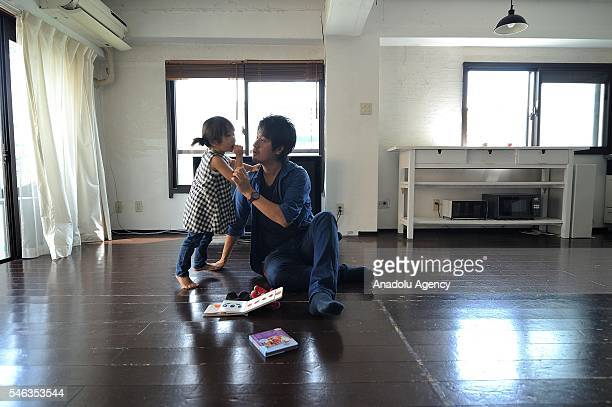 Minimalist Naoki Numahata talks to his threeyearsold daughter Ei in the center of the living at their home in Tokyo Japan on July 02 2016 Naoki...