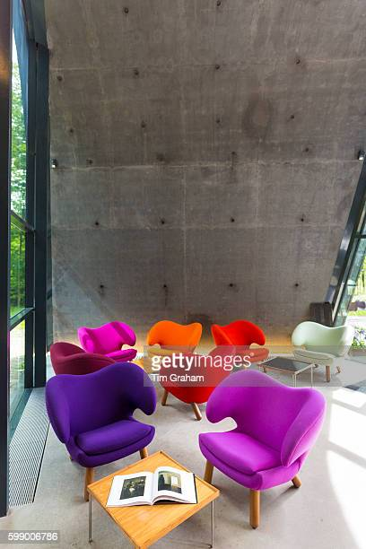 Minimalist Pelican chairs by Danish designer Finn Juhl in building by Zaha Hadid Ordrupgaard Art Design Museum Denmark