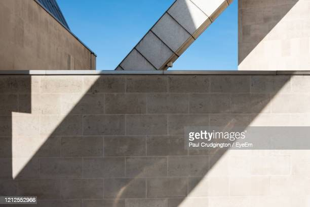 minimalist photo of geometric shapes created by sunlight, shadows and parts of a building. - liverpool england stock pictures, royalty-free photos & images