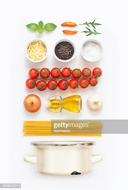 Minimalist style flat lay pasta recipe ingredient and cooking pot on white background.