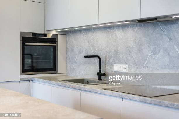 minimalistic kitchen design - electric stove burner stock pictures, royalty-free photos & images