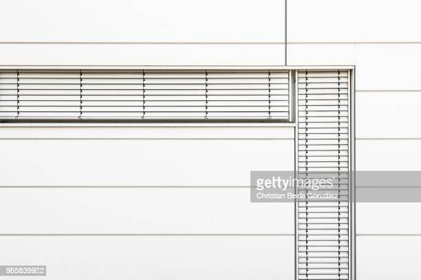 minimalistic office facade in white - christian beirle gonzález stock-fotos und bilder