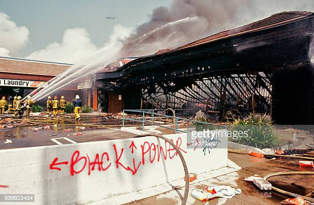 Mini-mall is looted and burned in South Central Los Angeles. Los Angeles has undergone several days of rioting due to the acquittal of the LAPD...