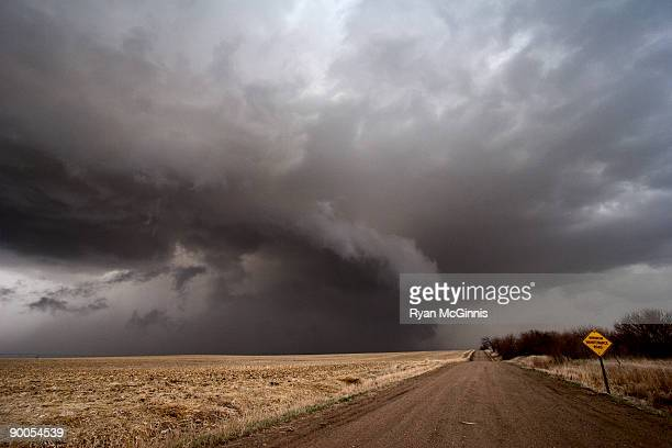 minimum maintenence road storm - ryan mcginnis stock photos and pictures