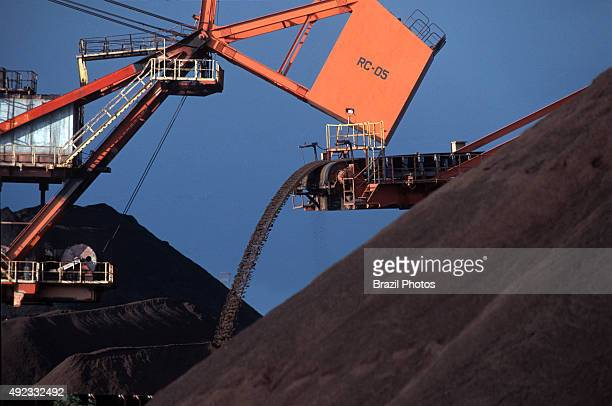 Mining Brazilian commodity conveyor belt transportation of iron ore for exportation at Tubarao Harbour in Vitoria city Espirito Santo State Brazil