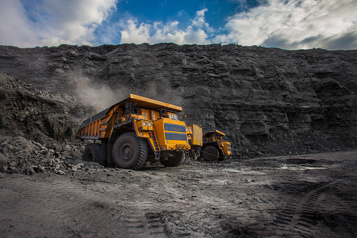 mining dump trucks loaded in a coal mine 1140210776