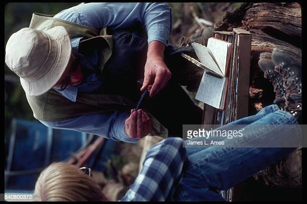 A mining engineer examines a core sample collected for a feasiblity study of platinum mining done by the JohnsManville Corporation in Stillwater...