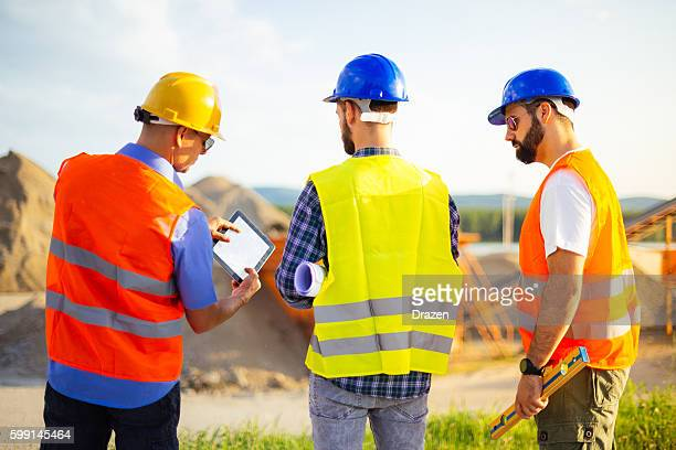 Mining engineers at mining pit