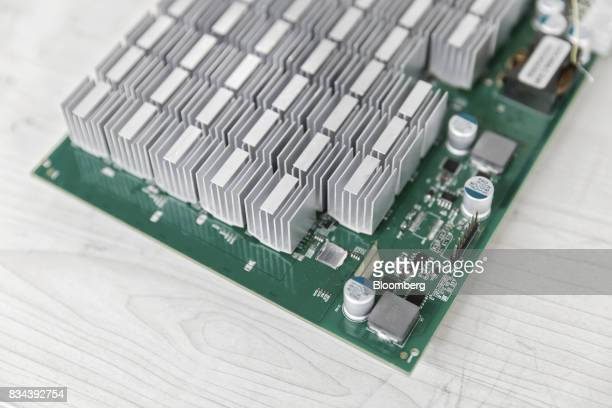 A mining machine component sits in the research and development department at Bitmain Technologies Ltd's headquarters in Beijing China on Thursday...