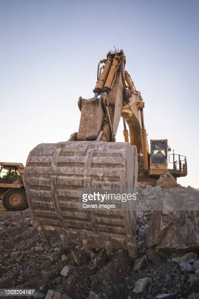 mining machinery working over rocks - archaeology stock pictures, royalty-free photos & images